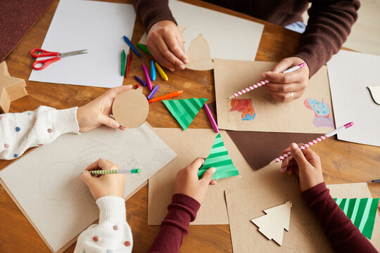 Above view close up of children drawing pictures during art and craft class in school, copy space