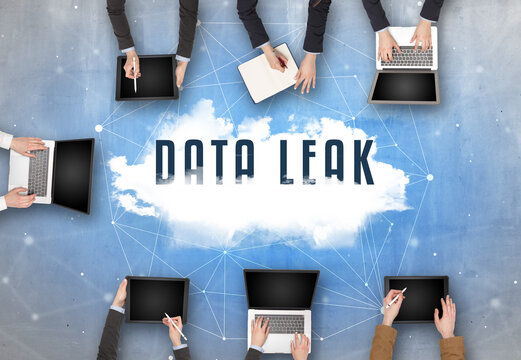 Group of people having a meeting with DATA LEAK insciption, web security concept