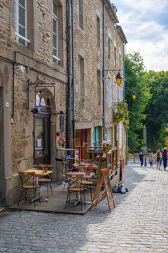 Pavement cafe in old cobblestoned street in Dinan, France