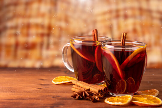 German tradition winter Christmas market new year holidays festival drink tea Gluhwein Mulled sweet hot warm red Wine with spices citrus aromatic cinnamon star anise