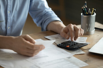 Personal finance management, accounting concept. Close up view man sitting at table using...