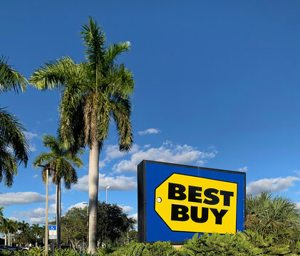 Best Buy an American consumer electronics retailer with a bright yellow, blue & black sign.