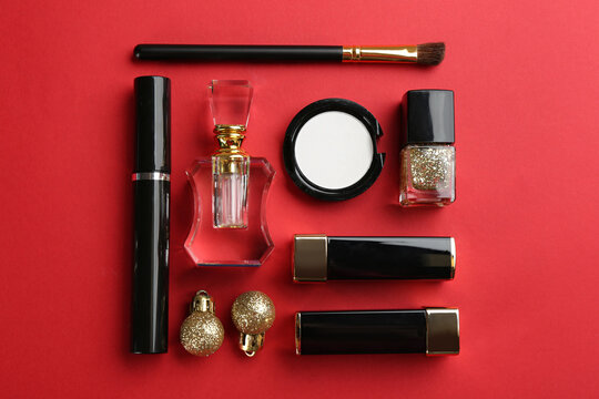 Flat lay composition with decorative cosmetic products on red background. Winter care