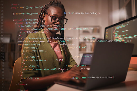Portrait of contemporary African-American woman using laptop with computer code overlay, copy space