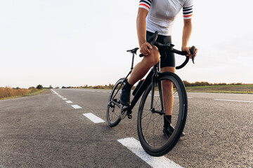 Close up of young man in cycling clothing riding on road