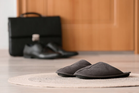 Male slippers on floor in hall. Concept of day off