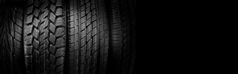 Car tires on black background, free space on right side for text.