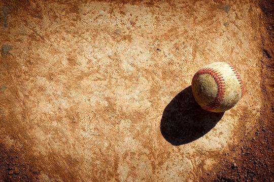 Old baseball on home plate