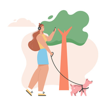 Young girl walking dog and listening music on headphones