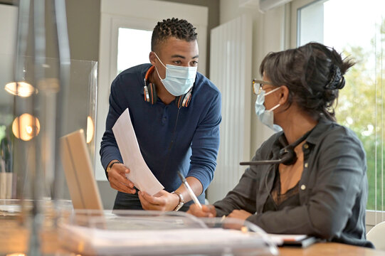 Start-up people working in co-working space office, wearing face mask during 19-ncov pandemic