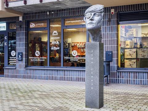 VILNIUS, LITHUANIA-NOVEMBER 21, 2017: John Lennon bust sculpture in Vilnius. This sculpture of the legendary musician was built by Saulius Paukštys in 2015.
