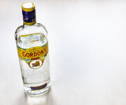 MOSCOW, RUSSIA - NOVEMBER 4, 2020: above view of bottle of Gordon's London Dry Gin on light brown board. Gordon's is brand of London dry gin first produced in 1769.