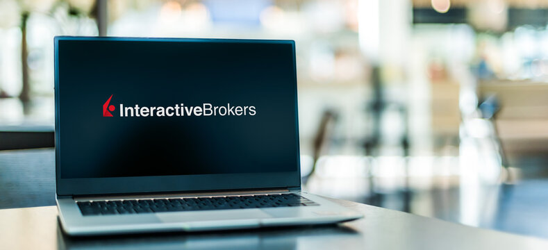 Laptop computer displaying logo of Interactive Brokers