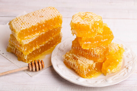 Lots of golden cut honeycomb on plate