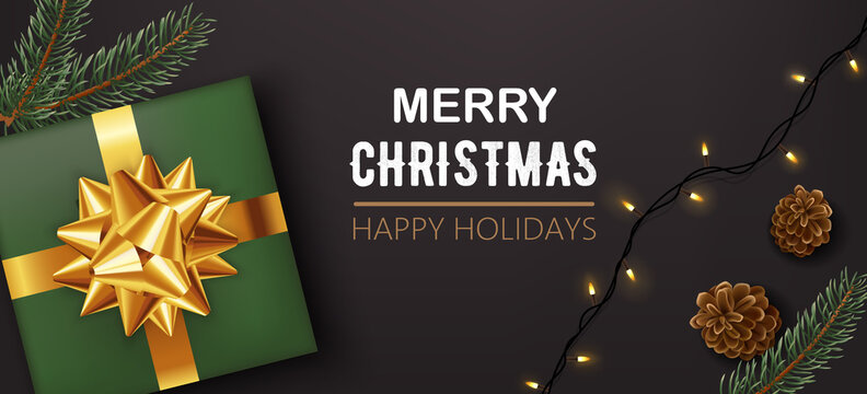 Green christmas gift box with golden ribbon with pine cones, twigs and festive lights. Happy holidays. Realistic 3D mockup product placement