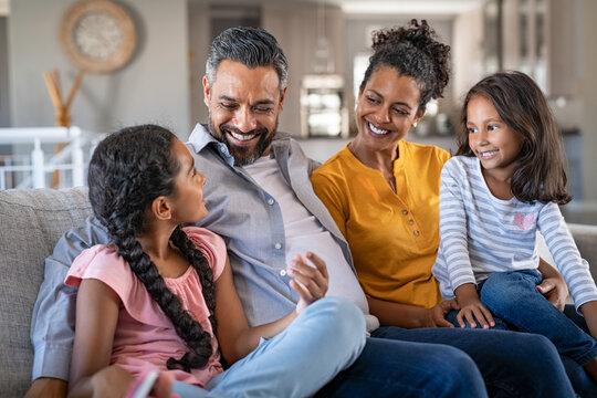 Happy joyful mixed race family having fun together