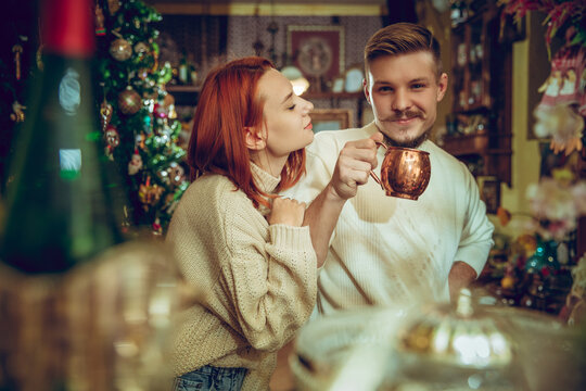Lovely. Smiling family, caucasian couple looking for home decoration and holiday's gifts in household store. Stylish and retro things for greetings or design. Interior renovation, celebrating time.