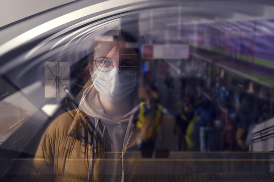 A woman in a medical mask on a metro platform, double exposure
