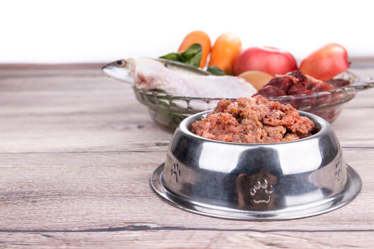 Minced barf raw food recipe ingredients for dogs consisting meat, organs, fish, eggs and vegetable