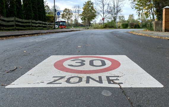 A 30km/h speed limit traffic road sign painted on the road for a school area in Germany