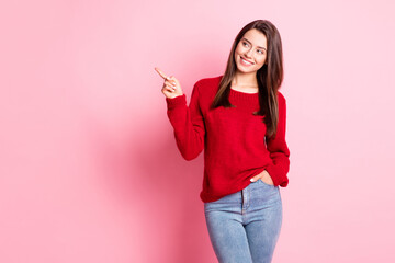 Photo of lovely girl hand pocket indicate forefinger look empty space wear red sweater jeans...