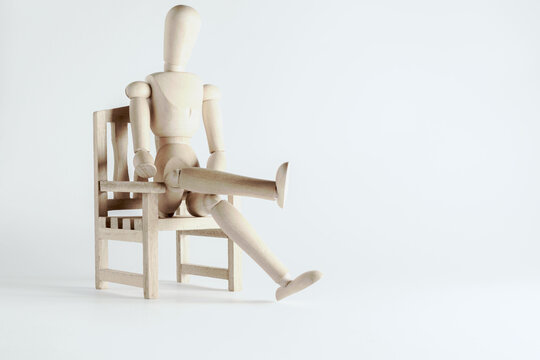 still life with seated wooden mannequin