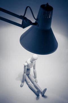 wooden mannequin under lamp, still life