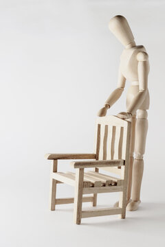 wooden mannequin with free chair