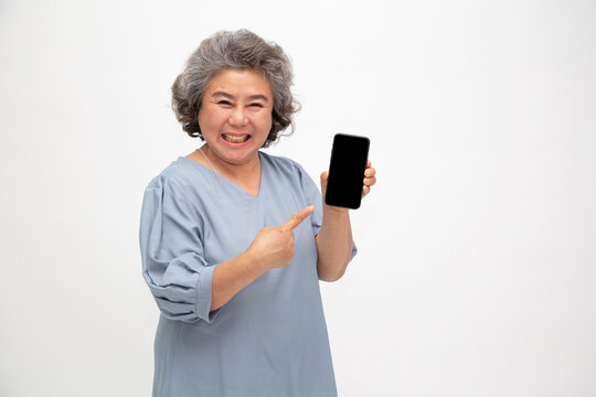 Asian senior woman showing or presenting mobile phone application on hand isolated on white background