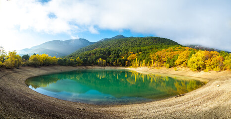 Turquoise lake in early autumn October hiking trip