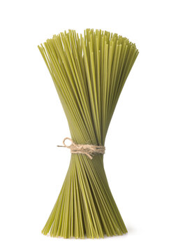 Bunch of green uncooked spinach spaghetti