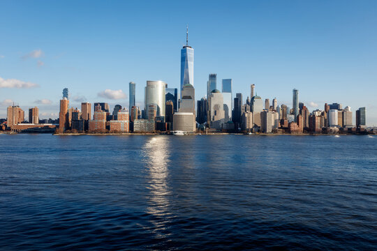 New York City Manhattan skyline daytime with One World Trade Center Tower (Freedom Tower)over Hudson River viewed from New Jersey