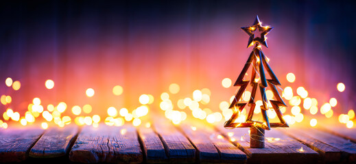 Printed kitchen splashbacks Asia Country Christmas Light And Wooden Tree On Table With Defocused Rustic Background