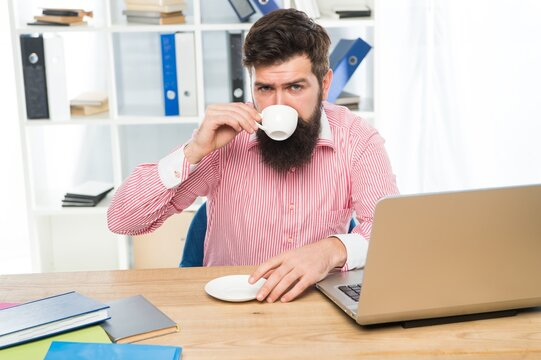 Drink coffee to stay on task. Businessman enjoy coffee break in workplace. Drinking hot cup in morning. Office life. Caffeine makes him more productive