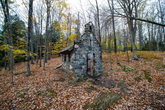 Tiny church in woods during Fall near Stowe Vermont