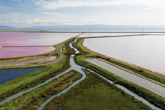 Multi Colored Water in Ponds and Stream in Salt Marsh in SF Bay Aerial