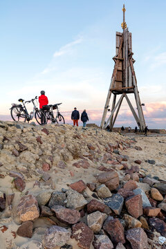 The 'Kugelbake', a historic aid to navigation in the city of Cuxhaven, Germany, at the northernmost point of Lower Saxony, where the River Elbe flows into the North Sea at sunset.
