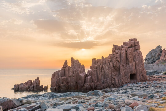 """Geological feature called """"Rocce rosse"""" (red rocks) along the coastline in Arbatax (Sardinia, Italy) at the sunrise"""