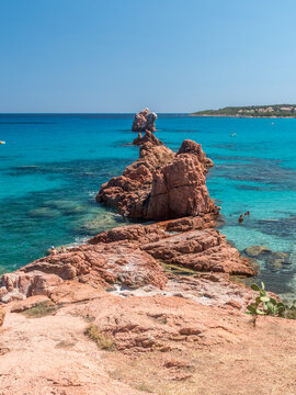 Red rocks at the edge of the beach of Cea near Arbatax (Sardinia, Italy)