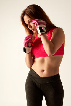 Attractive Female Boxer At Training with gloves