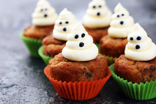 halloween cupcake and pumpkin on a dark background. sweets with cupcakes for the celebration of spooky Halloween.