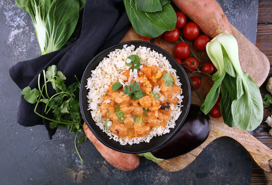 Chicken tikka masala spicy curry meat food in pot with rice and naan bread. indian food
