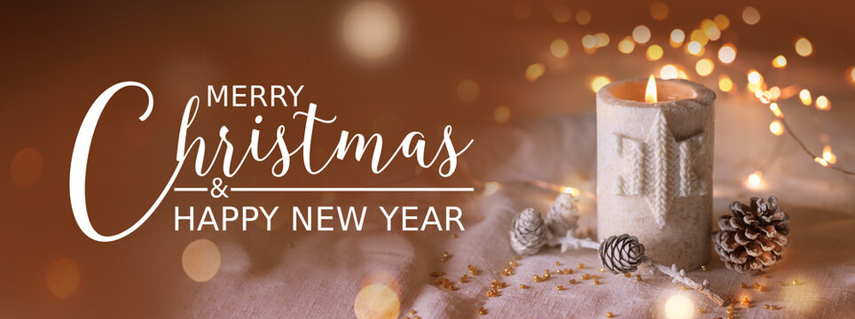 Merry Christmas and Happy New Year,  Christmas Card, Natural Christmas decoration with burning candle on white linen and pine cones - magic lights in background