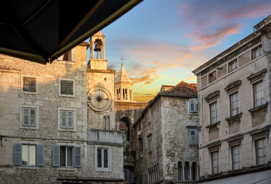 The bell and cathedral towers reflect the sun on a summer morning on People's Square at Diocletian's Palace in Split Croatia