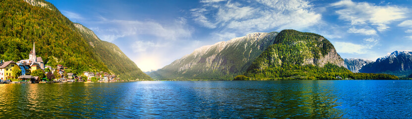 Scenic panoramic view of famous Hallstatt lakeside town reflecting in Hallstättersee lake in the...