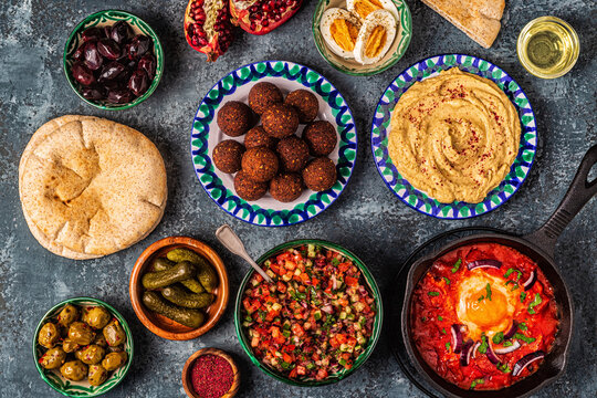 Falafel, hummus, shakshuka, Israeli salad - traditional dishes of Israeli cuisine.