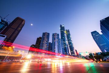 light trails on the street with modern building background in Nanchang,China.Translation: