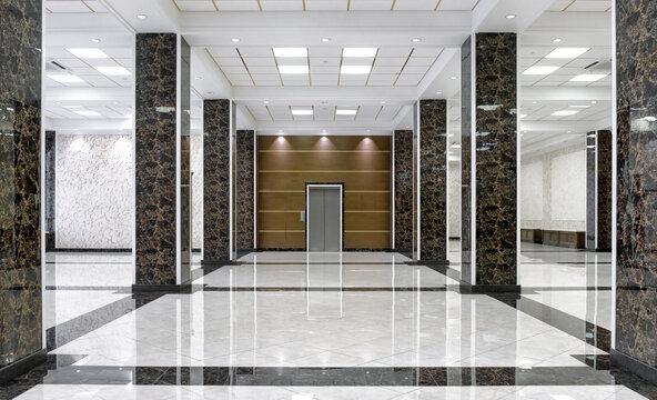 Clean floor in commercial lobby, marble shiny tiles in office hall