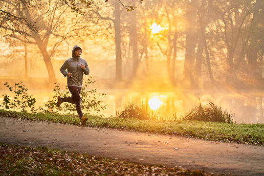 Runner in the park during autumn fall sunny morning