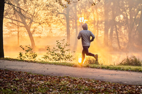 Man running during autumn fall in the park